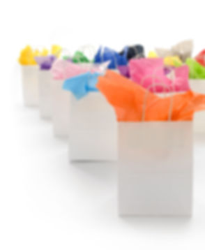 White shopping bags with colorful tissue
