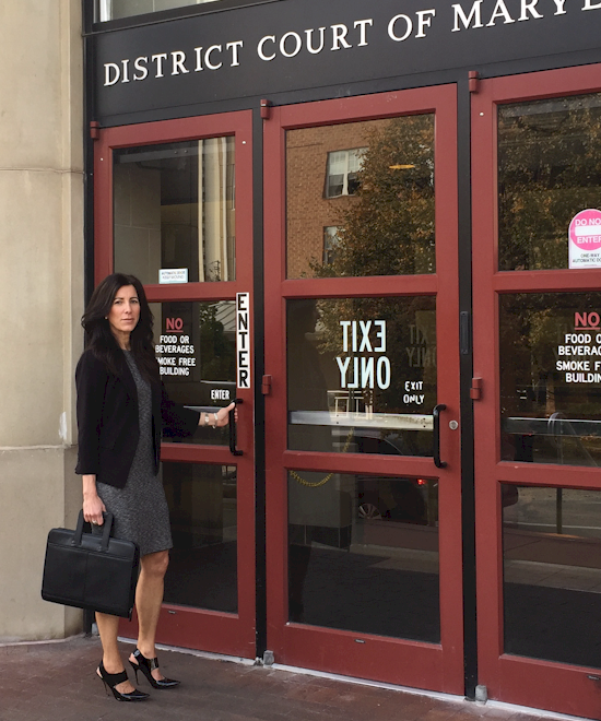 Debt collection attorney entering Maryland Courthouse