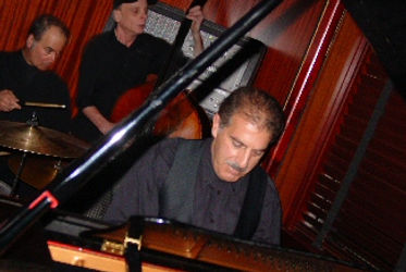 Joe Benedict playing piano with trio Joe Benedict Pianist