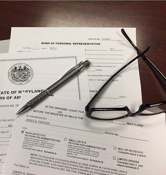 Probate lawyer paperwork & reading glasses