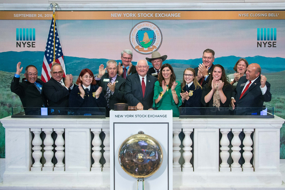 Dr. Glenn (far right back row) attends the closing bell of the New York Stock Exchange with U.S. Secretary of Agriculture Sonny Perdue and other leaders in agriculture.