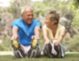 Senior Couple Exercising In Park.jpg