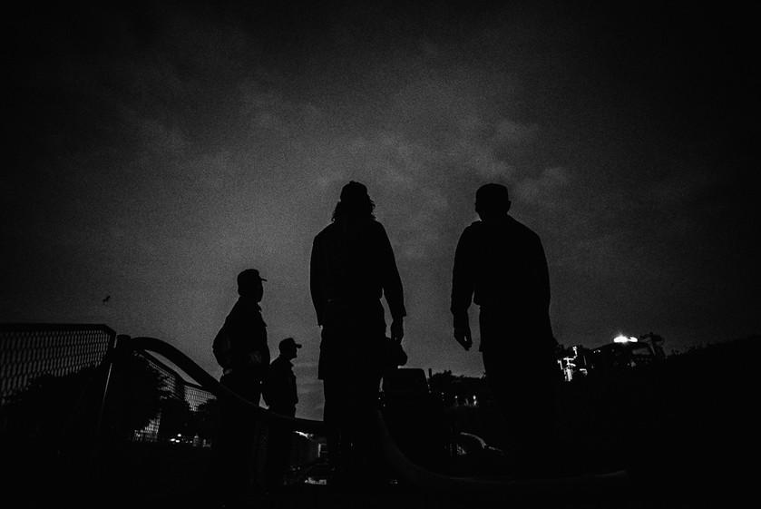 Members wait at the end of a maneuver during training at Tamagawa river.