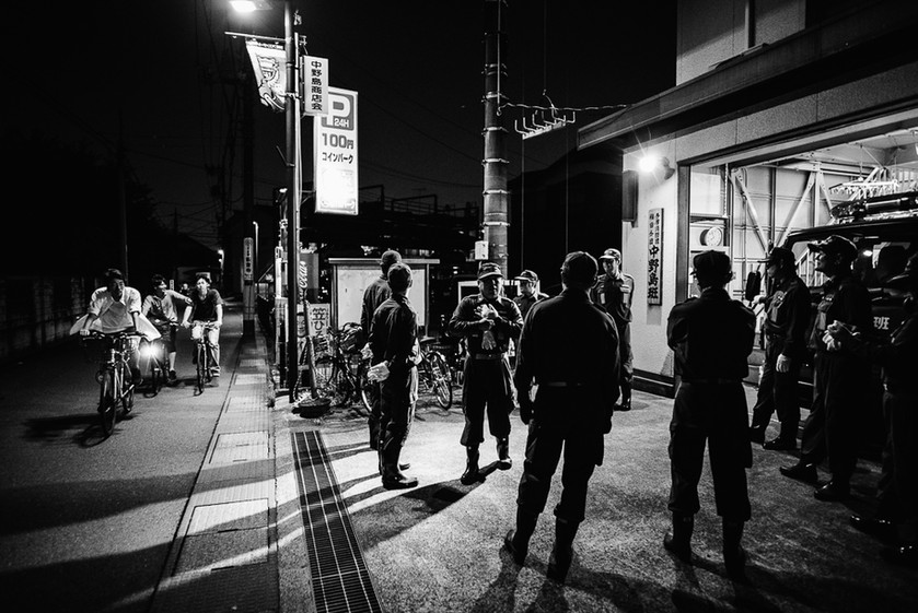 Team members gather outside Nakanoshima Station before training.