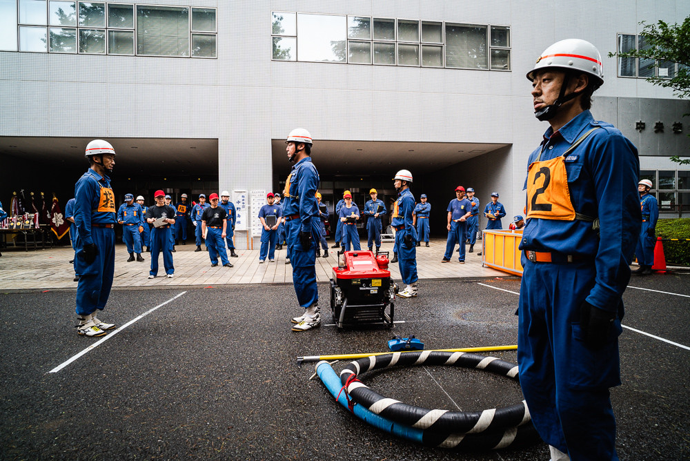 Masafumi (right) stands to attention with three other members shortly before beginning their maneuver at the 2019 competition.