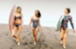 Brooke Walker wears a Chica Bonita bikini set size M, Maria de los Angeles wears a Sunkissed one piece size M and Nicole Krumenacker wears an Ocean Rider surf suit size M all on Tropicalia Print. Photo credit: Sansara Resort, proud retailer of Almeda Swimwear.