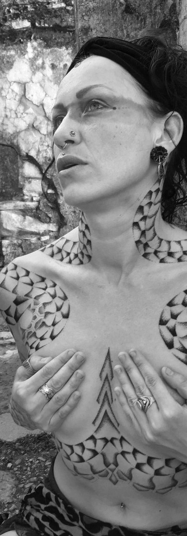 miriam serpent tattoo.jpg