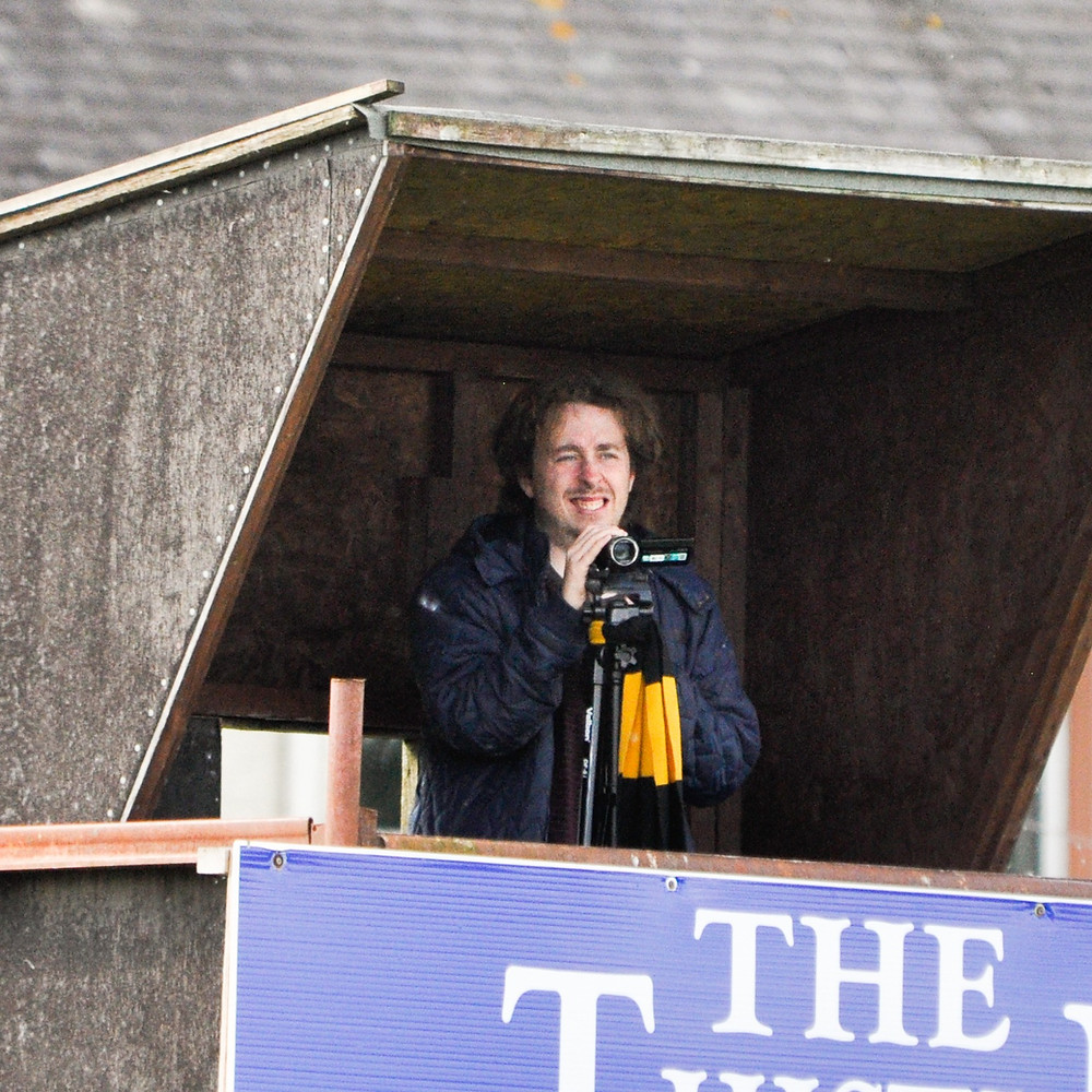 Paul Laing, holding a camcorder and under a covered enclosure at Hurlford, in 2018.