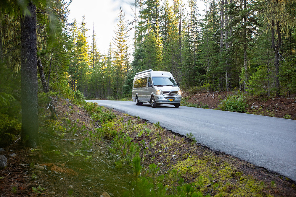 caravan traveling through the woods exampling how to offer rv travel to your customers