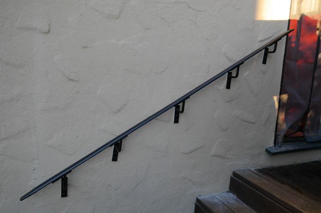Simple Bronze Handrail for a Garden