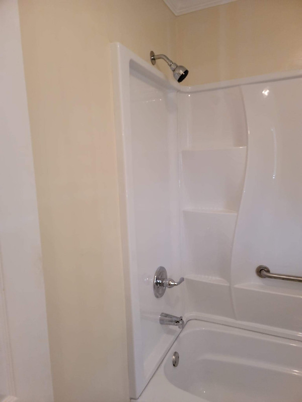 After Photo of a brand new shower/tub install and fresh paint