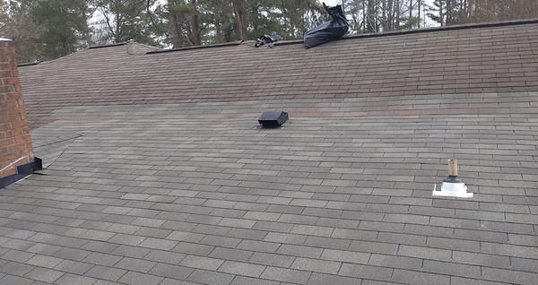 New roofing Tying into the Existing Roof over a deck