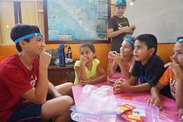 Visiting and local Costa Rican students playing games