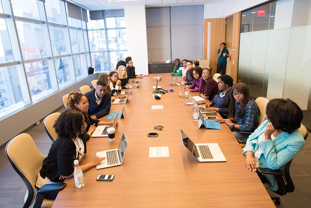 Diversity of people meeting around a board room table