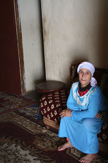 Moroccan woman in her house in the slumsof Morocco