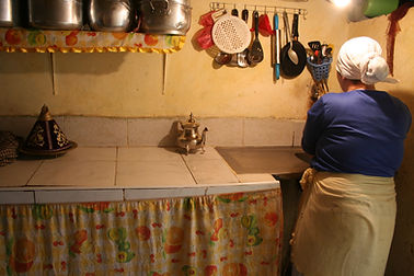Woman in her kitchen in slums of Morocco