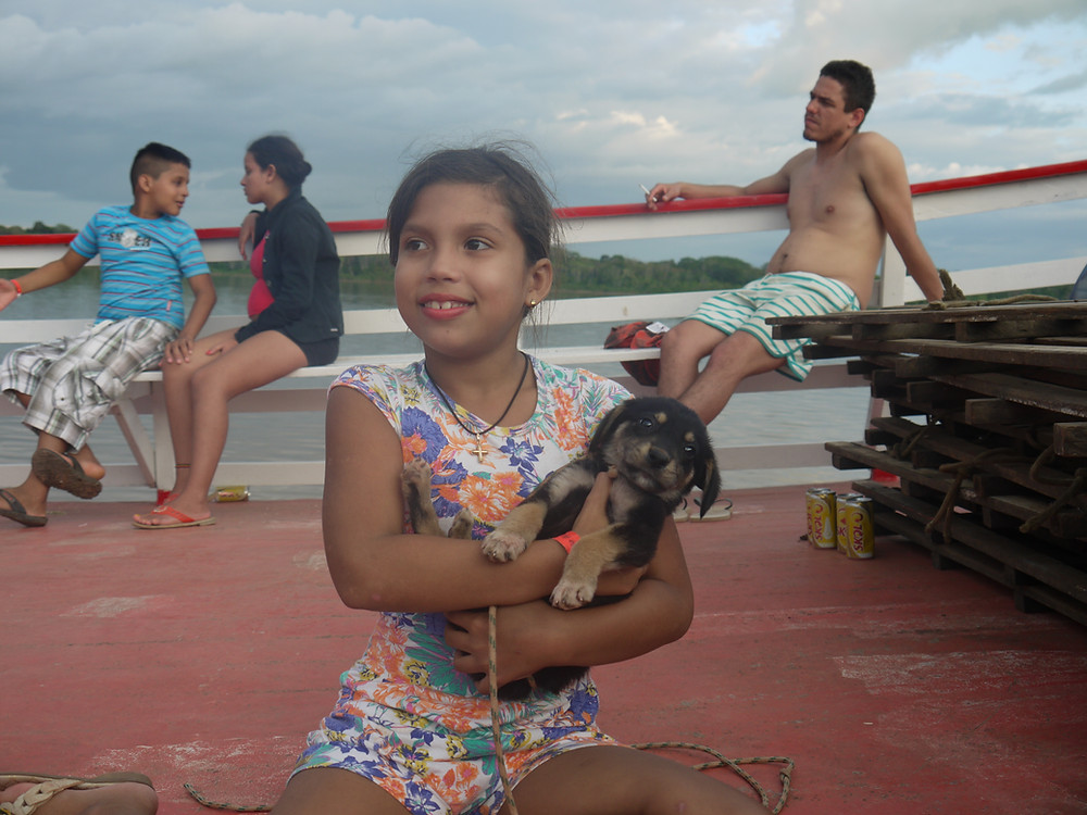 Boat trip Amazon river with dog
