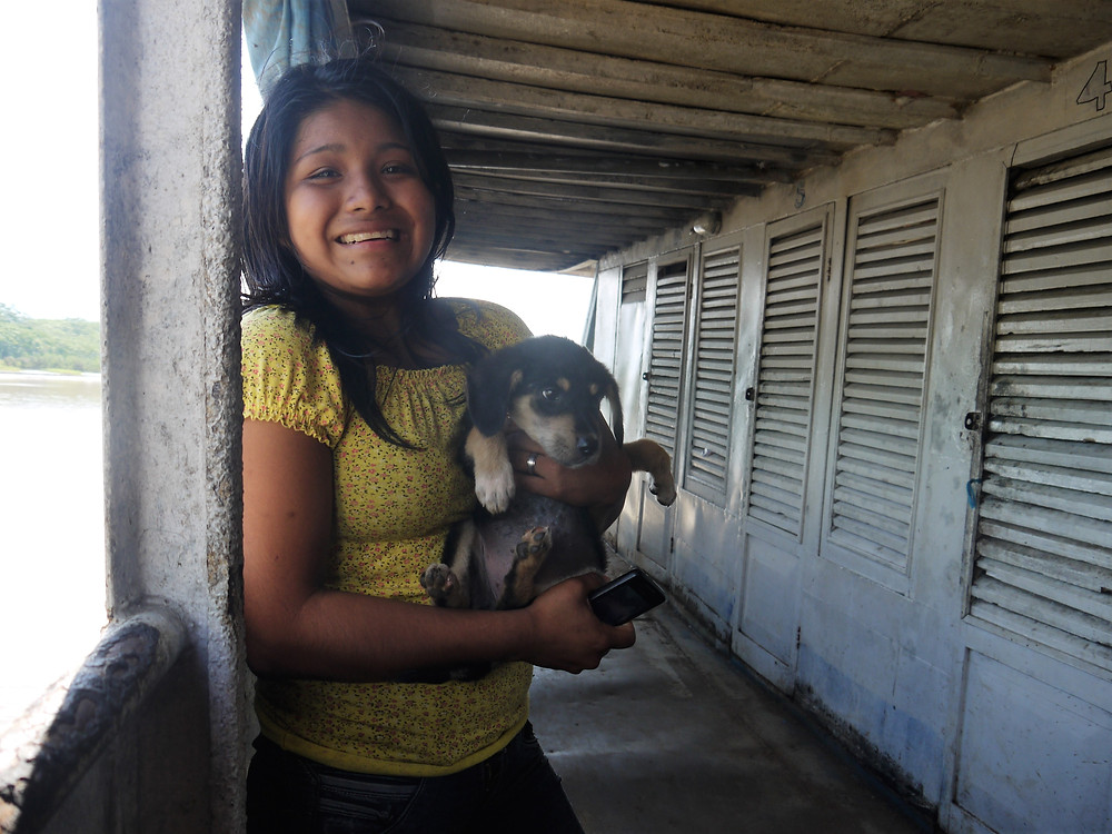 Traveling with my dog Peru Amazon boat