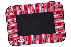Handwoven dog bed with waterproof bottom in striking pattern of red, black, and white