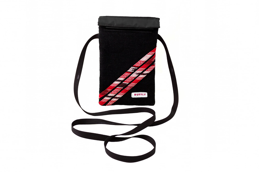 black, red and white cross body bag with strap