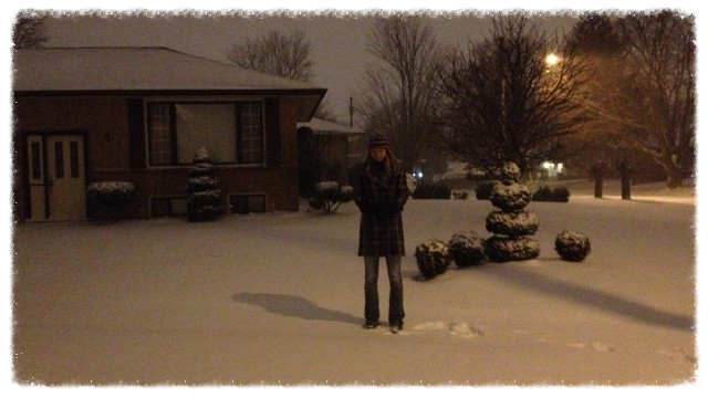 Jess in front of her parents' home in day-after-Christmas snow