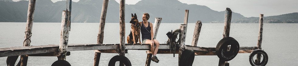 woman-sits-happily-with-German-Shepherd-