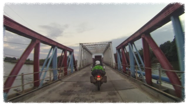 Jess rides Haulover Bridge into Belize City