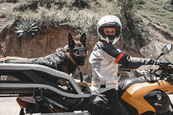 Jess Stone and German Shepherd Moxie pose for a photo with their K9 Moto Cockpit motorcycle dog carrier
