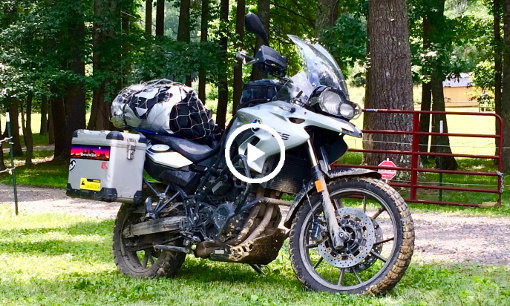 BMW F700GS motorcycle equipped for long distance travel and off-road adventures
