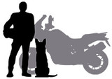 Silhouette of man and dog beside adventure motorcycle