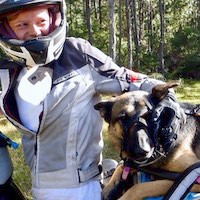 Woman and German Shepherd on motorcycle