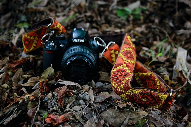 Vegan, handmade strap with dual stainless size adjusters attached to Nikon camera