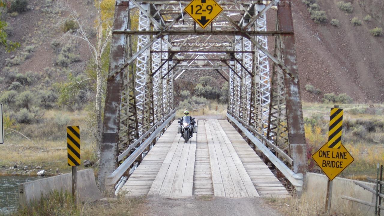 Greg crosses bridge - off Highway 93 near Challis, ID, USA