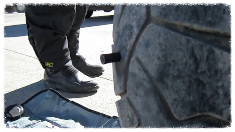 The tools, my feet, and the plug in my tire