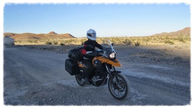 Jessica rides dirt road between Puertecitos and Chalapa in Baja California