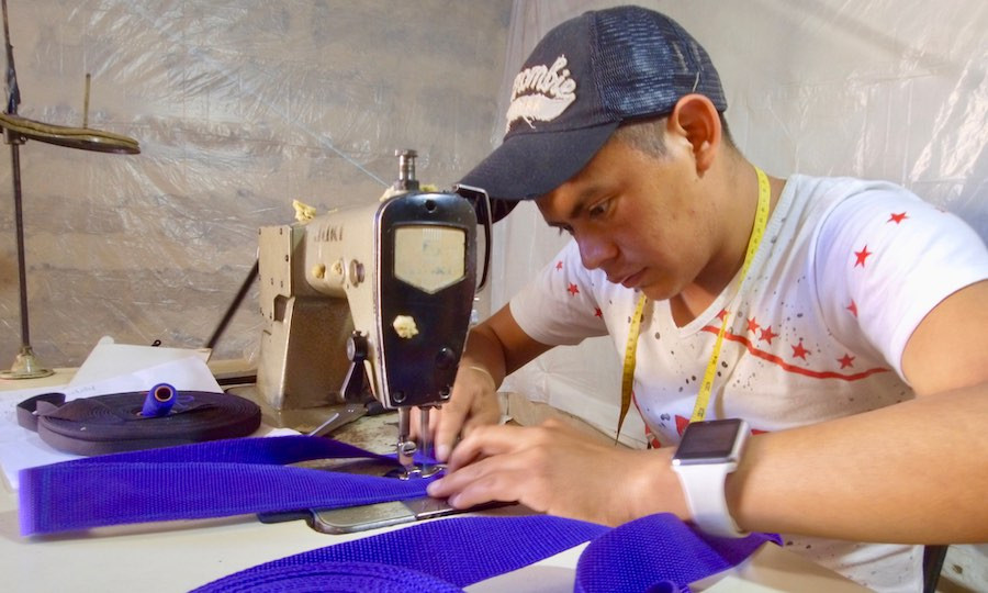 Guatemalan tailor sews handmade dog collar