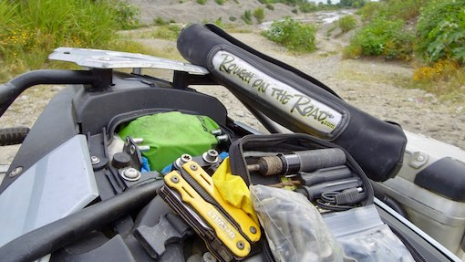 Assortment of tools and tire repair kit on BMW F700GS motorcycle