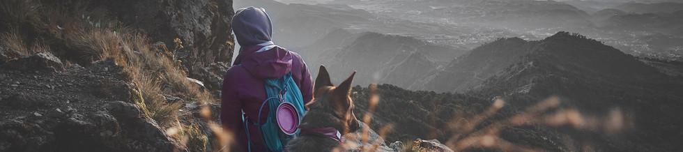 woman-and-german-shepherd-dog-sit-on-mou