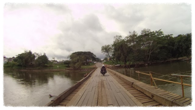 Jess rides across bridge into San Ignacio