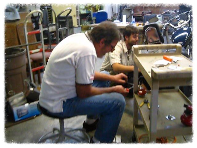 Greg and Dan prep the motorbike