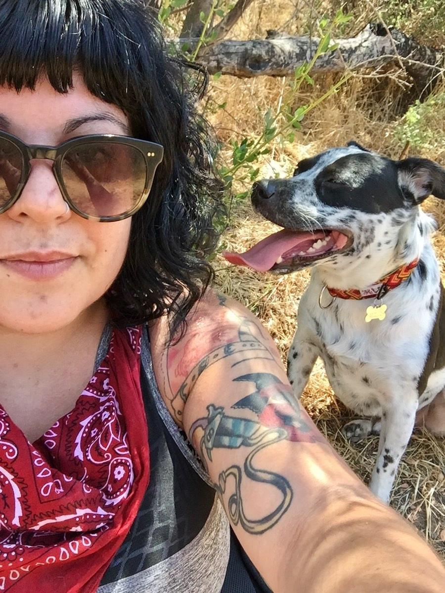 dog wears handmade collar and hipster girl
