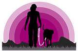 Silhouette of woman and dog walking into a pink sunset