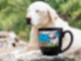 Pensive-lookiing White dog lies on rocks with same engraved, hand-painted image on black 16oz latte mug