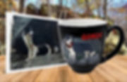 Image of furry black and white dog standing on boulders engraved and hand-painted on latte coffee mug