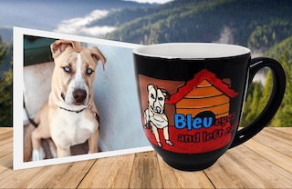 Photo of grey and white dog with blue eyes and floppy ears beside latte mug with same image engraved and painted