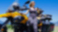 Blonde woman and German Shepherd dog pose together with BMW G650GS adventure motorcycle