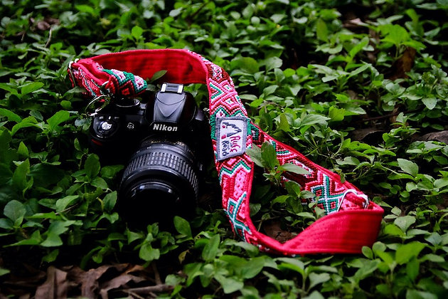 Handmade macrame and woven fabric camera strap in candy colors attached to Nikon