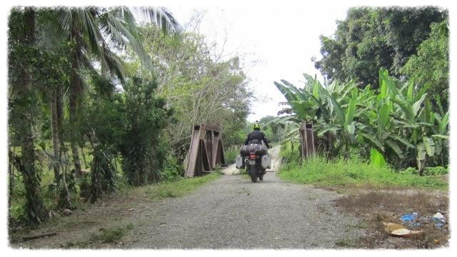 20140116_14_21_41_Greg_rides_over_bridge_near_Guabito_Bocas_del_Toro_Panama__edited.jpg