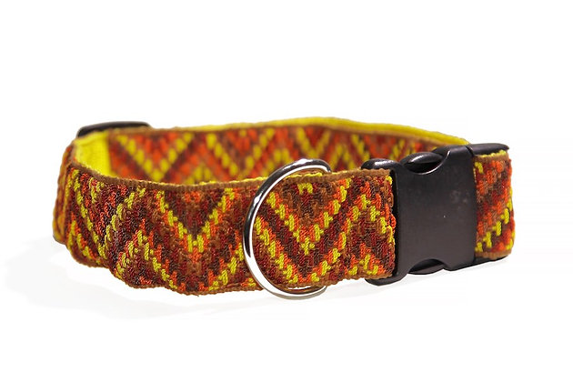 Handmade woven dog collar in patterns of upward-facing chevrons in rich, brown shades