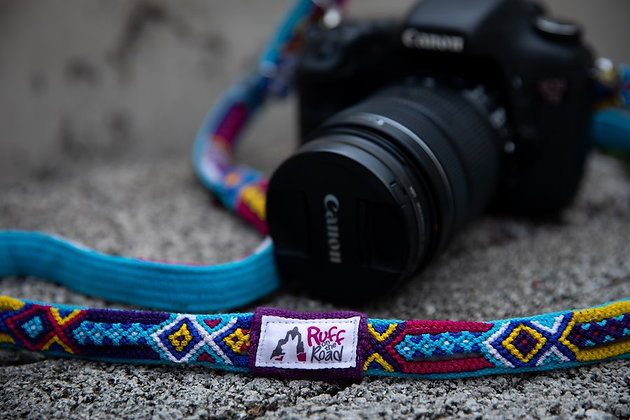 Canon camera attached to handmade blue camera strap